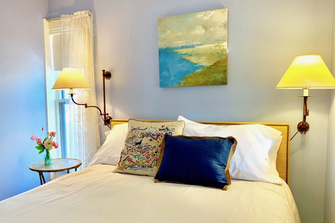 Queen size bed and ocean painting